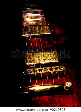 music concept with red electric guitar isolated on black background in dark - stock photo