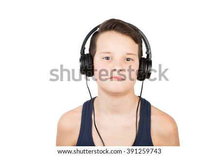 Music concept - Young beautiful teenager boy with headphones on head isolated over a white background