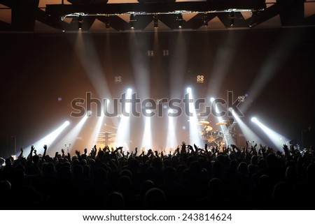 Music concert with audience and lights from the stage - stock photo