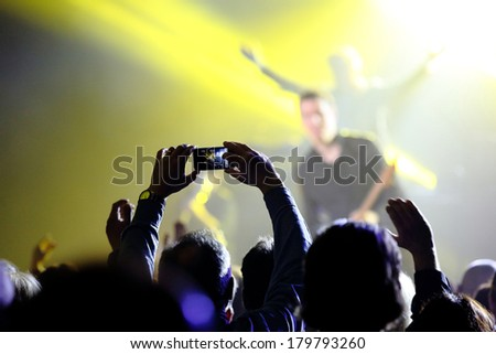 Music concert with audience, musicians and man doing a photo - stock photo