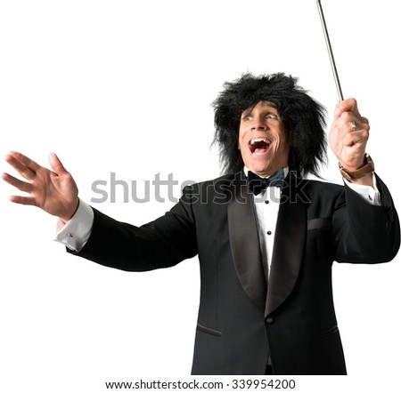 Music conductor wearing a tuxedo leading music with baton - Isolated - stock photo