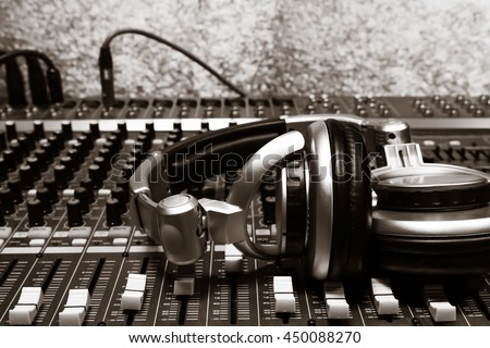 music dj concept the beautiful headphone on sound mixer music background with copy space. - stock photo