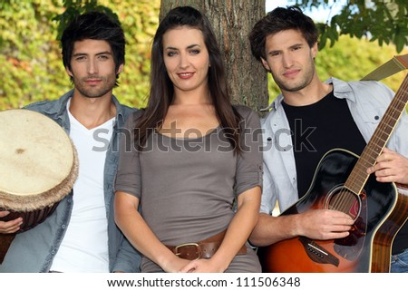Music group in park - stock photo