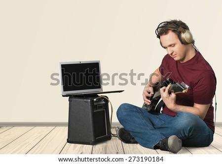 Music, Guitar, Computer. - stock photo