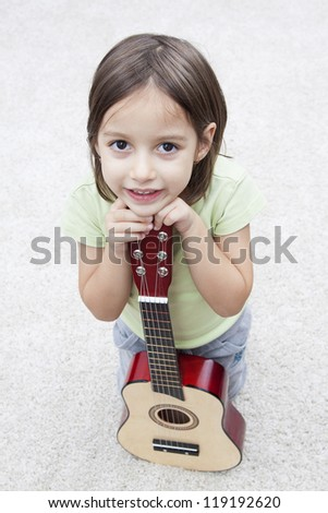 music instrument - little girl with guitar - stock photo
