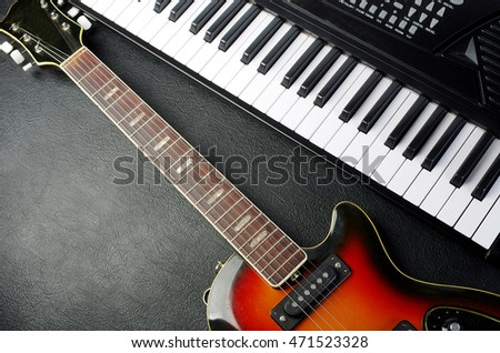 Music instruments.Keybord synthesizer and electric guitar