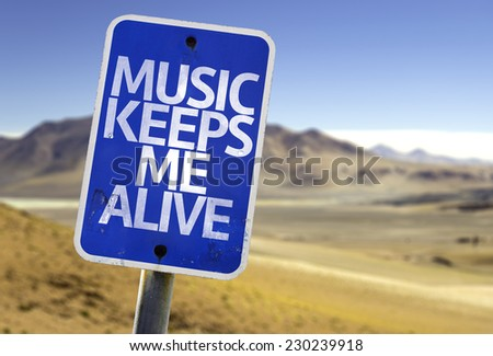 Music Keeps Me Alive sign with a desert background