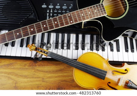 Music keyboard, acoustic guitar, violin.