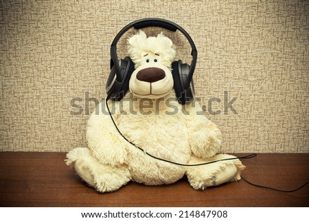 Music lover in headphones. photo toned yellow  - stock photo