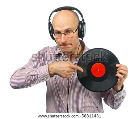 Music lover in headphones shows old music disc
