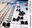 music mixer in studio closeup - stock photo