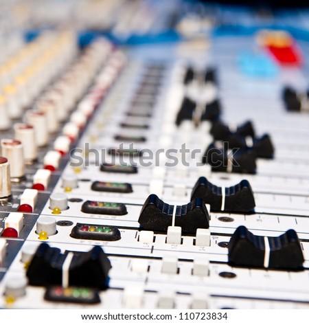 music mixer in studio closeup - stock photo