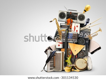 Music, musical instruments and vintage tape recorders - stock photo
