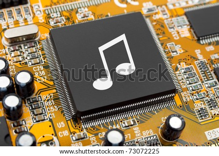 Music note on computer chip - technology concept - stock photo