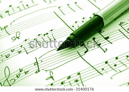 music notes and pen - stock photo
