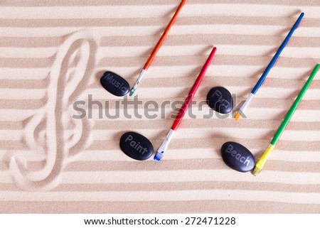 Music, Paint and Fun at the Beach for Resort Activities, G clef at the left music notes made out of colorful paint brushes and black rocks writing music, paint, fun, and beach - stock photo