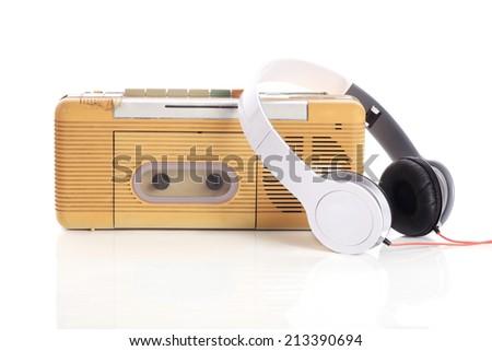 music radio and white headphone on white background - stock photo