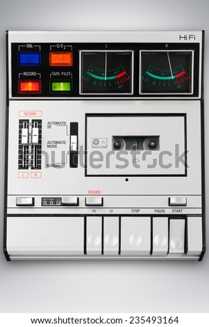 Music recording playing in motion. Cassette recording. - stock photo