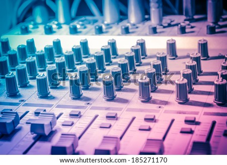 Music studio, sound studio adjusting record equipment - stock photo