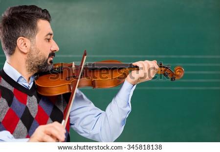 Music teacher on green board. - stock photo