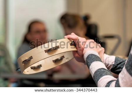 Music therapy for disabled children playing in a group / Working with mentally handicapped people