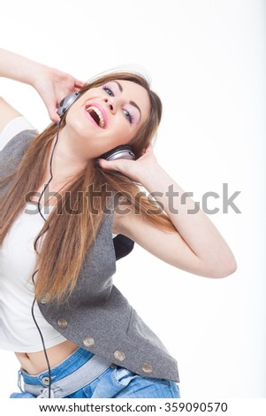 Music. Woman with headphones listening to music on mp3 player isolated on white background