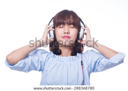 Music,Young woman holding headphones with white background