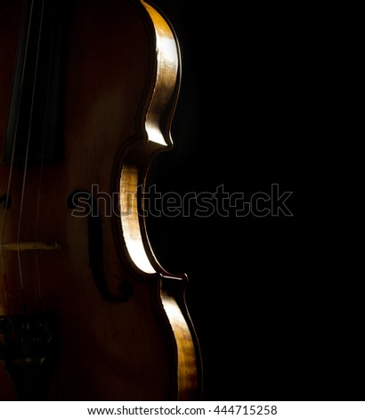musical background with violin side on black - stock photo
