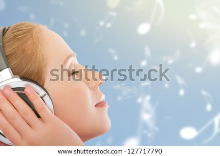 musical concept. woman with headphones relax, enjoy the music on the sky background with notes - stock photo