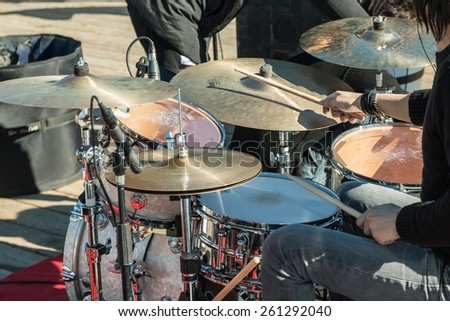 musical drums: hands with wooden sticks - stock photo