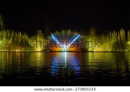 Musical fountain with colorful illuminations at night, Vinnitsa, Ukraine - stock photo