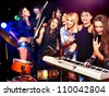 Musical group male and female  performance in night club. - stock photo