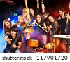 Musical group performance in night club. Lighting effects. - stock photo