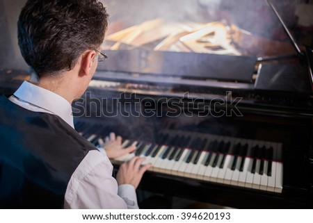 Musical instrument grand piano with man performer