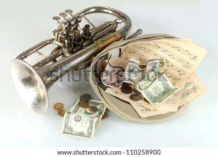musical instrument with money isolated on white