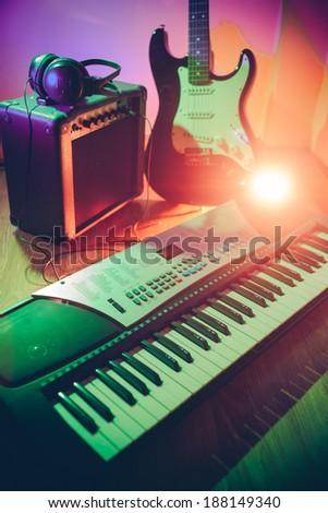Musical instruments,amplifier guitar and keyboard - stock photo