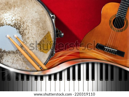 Musical Instruments Background / Red velvet background with acoustic guitar, piano keyboard and metallic old snare drum. Concept of music performance - stock photo