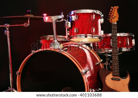 Musical instruments on a stage on dark background - stock photo
