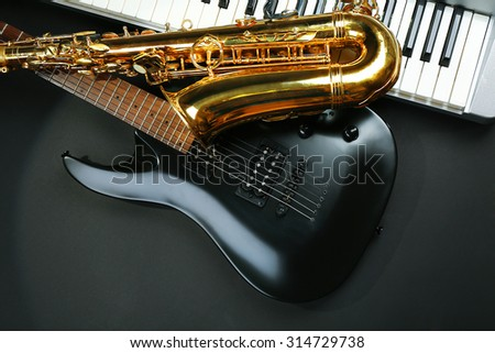 Musical instruments on dark background - stock photo