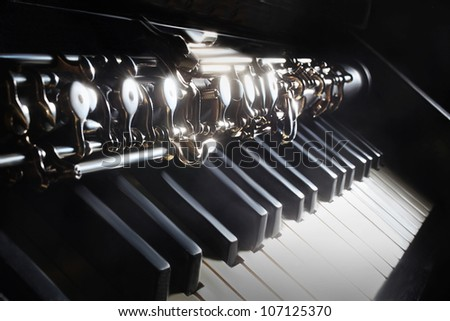 Musical instruments piano oboe. Classical music instrument on black