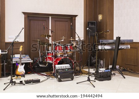 Musical instruments ready for a band to give a performance  - stock photo
