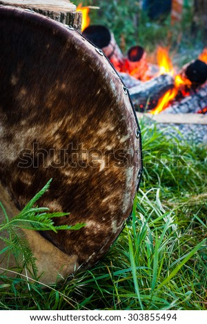 Musical instruments. Yoga. Veda. percussion, tambourine on a background of fire. - stock photo