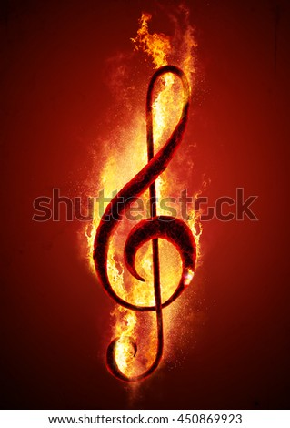 Musical note (treble clef) from hot charcoal on fire. Conceptual image of hot music.