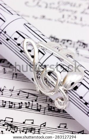 Musical notes and treble clef  - stock photo