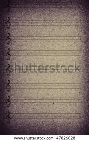 Musical signs on old texture of paper - stock photo