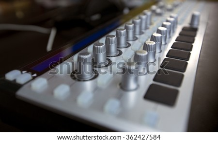Musical sound equipment use by dj in creating tunes. Turning knobs