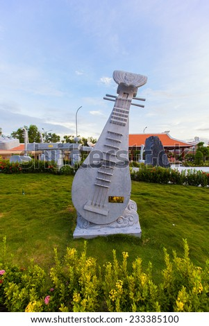 musical toy at Cao Van Lau statue of memorial house. Cao Van Lau is famous traditional music in Vietnam. The folk music was one of UNESCO of Intangible Cultural Heritage - stock photo