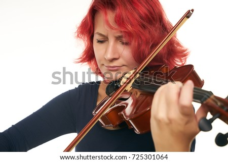 Musician beautiful young woman playing violin isolated on white background with copy space