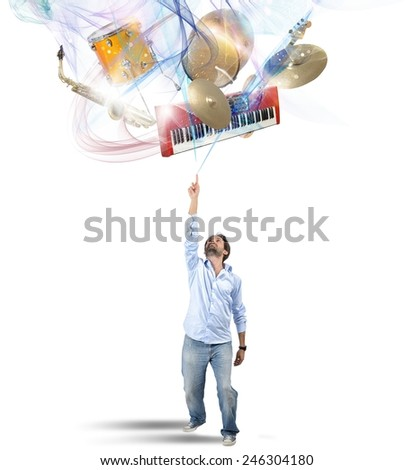 Musician chooses his instrument in colors vortex - stock photo