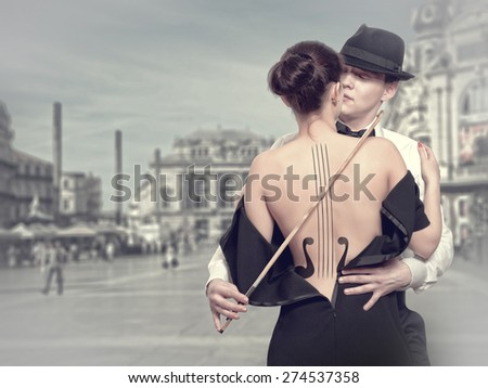 Musician inspired by the female muse - stock photo